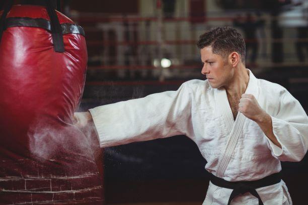 karate fighter hitting a punchbag