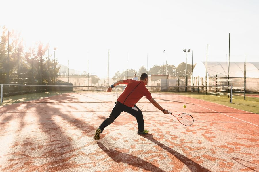 two tennis players on damp court