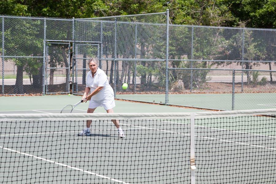 Senior lady playing tennis