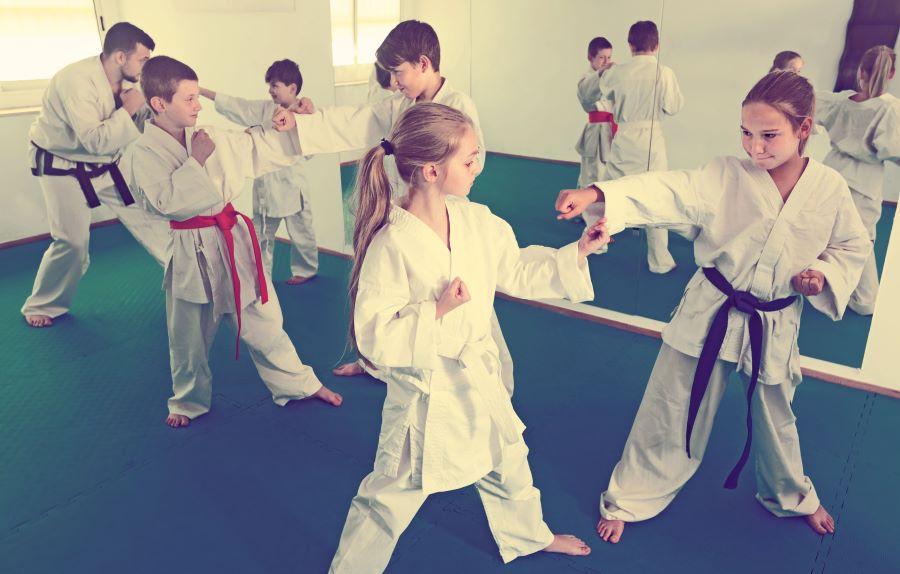 kids learning karate in a dojo