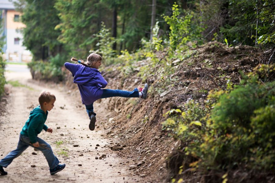 Kids trying karate moves out in the forest