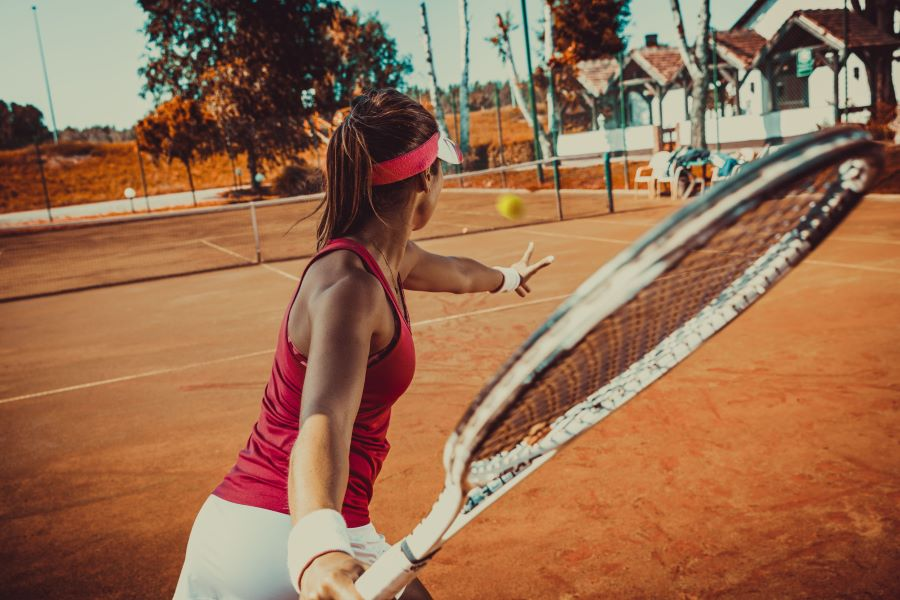 Female tennis player on outdoor clay court