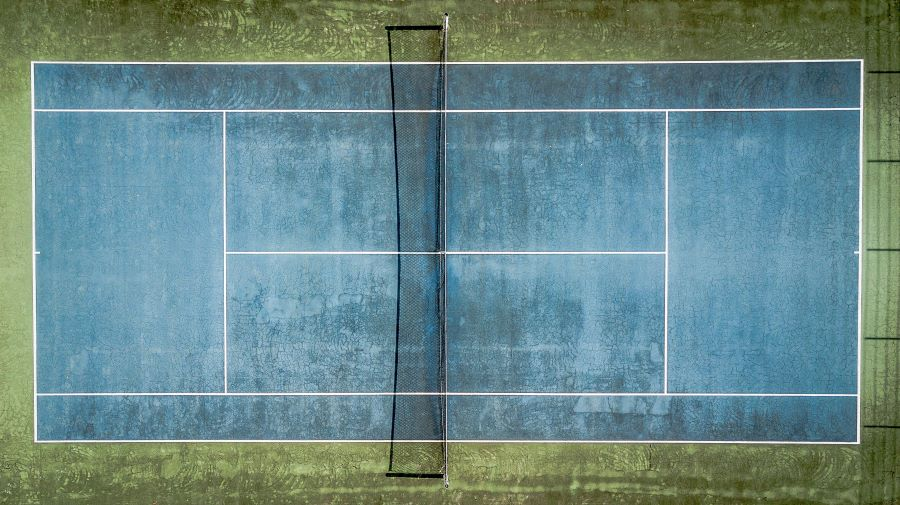Aerial view of a blue tennis court