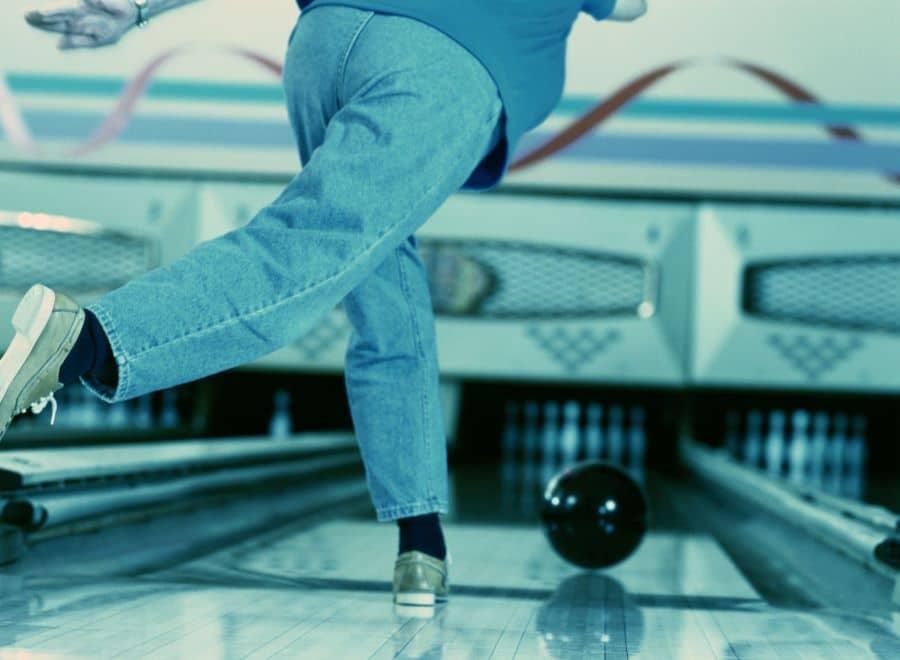 A man following through having just bowled a bowling ball